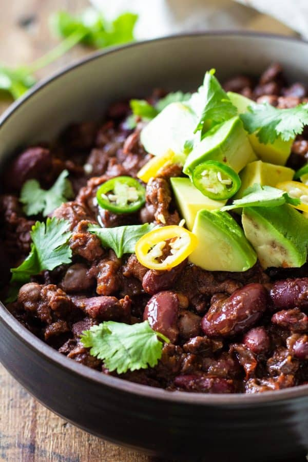 Vegan Instant Pot Chili topped with fresh avocado, cilantro and sliced chili