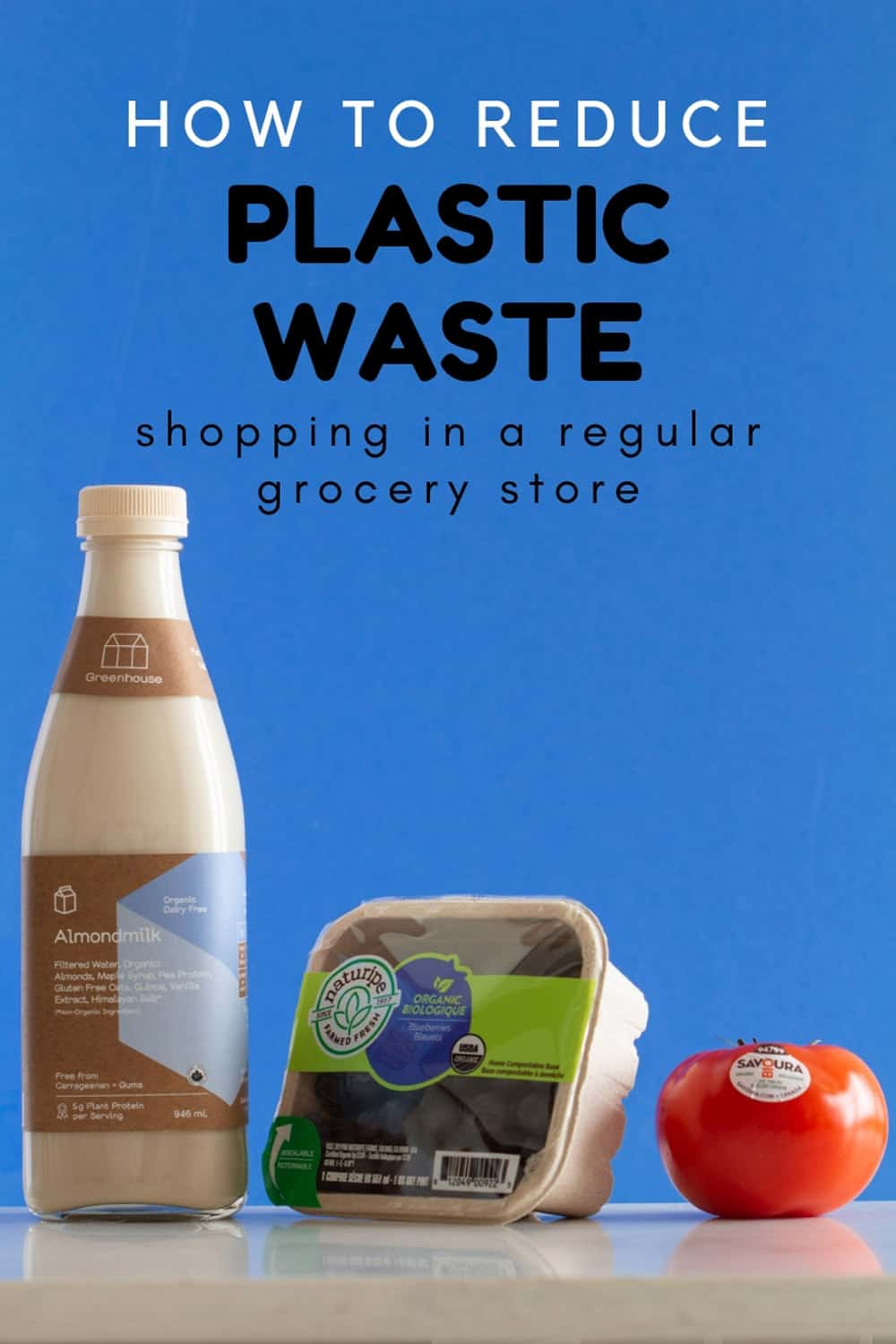 Glass Bottle with Almond Milk, Cardboard Box with Blueberries, Tomato with Sticker
