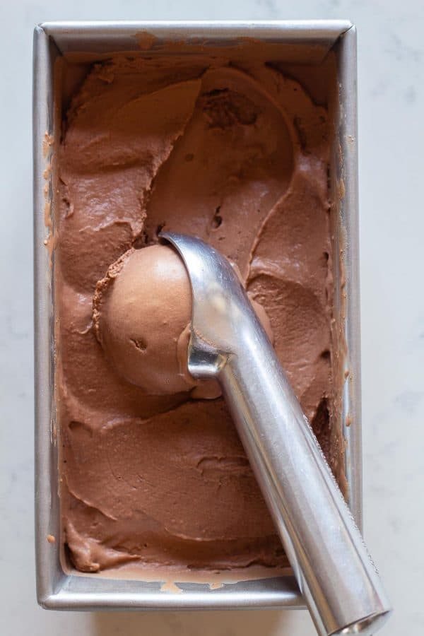 Chocolate Peanut Butter Ice Cream in a container scooped out with an ice cream scoop