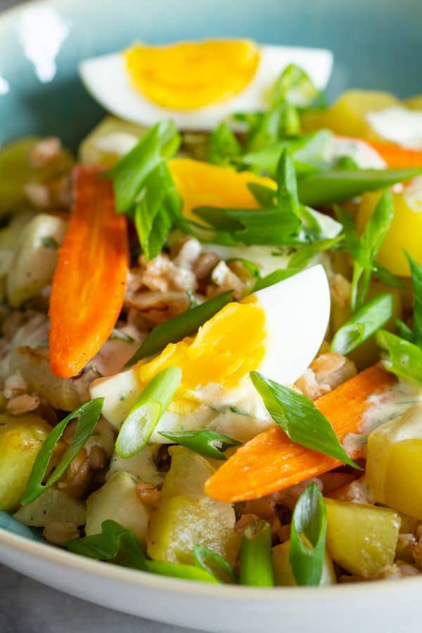 warm farro salad with hard boiled eggs and roasted vegetables