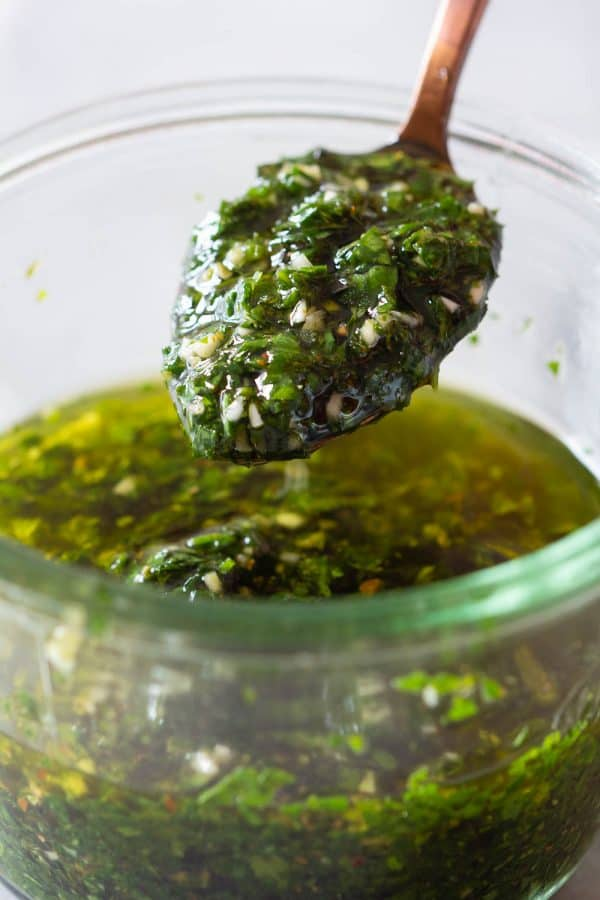 Chimichurri on a spoon and in a jar