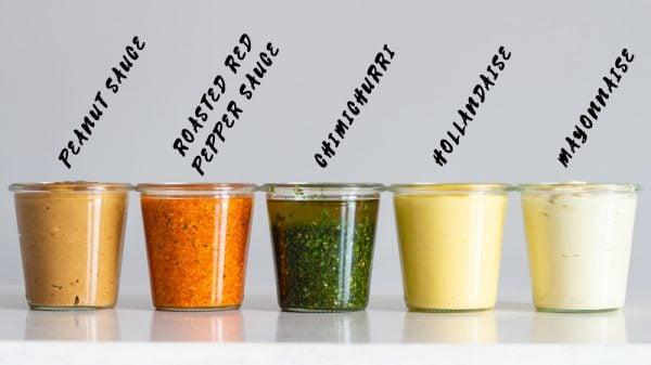 5 Keto Sauces in a jar, peanut sauce, roasted red pepper sauce, chimichurri, hollandaise, mayonnaise
