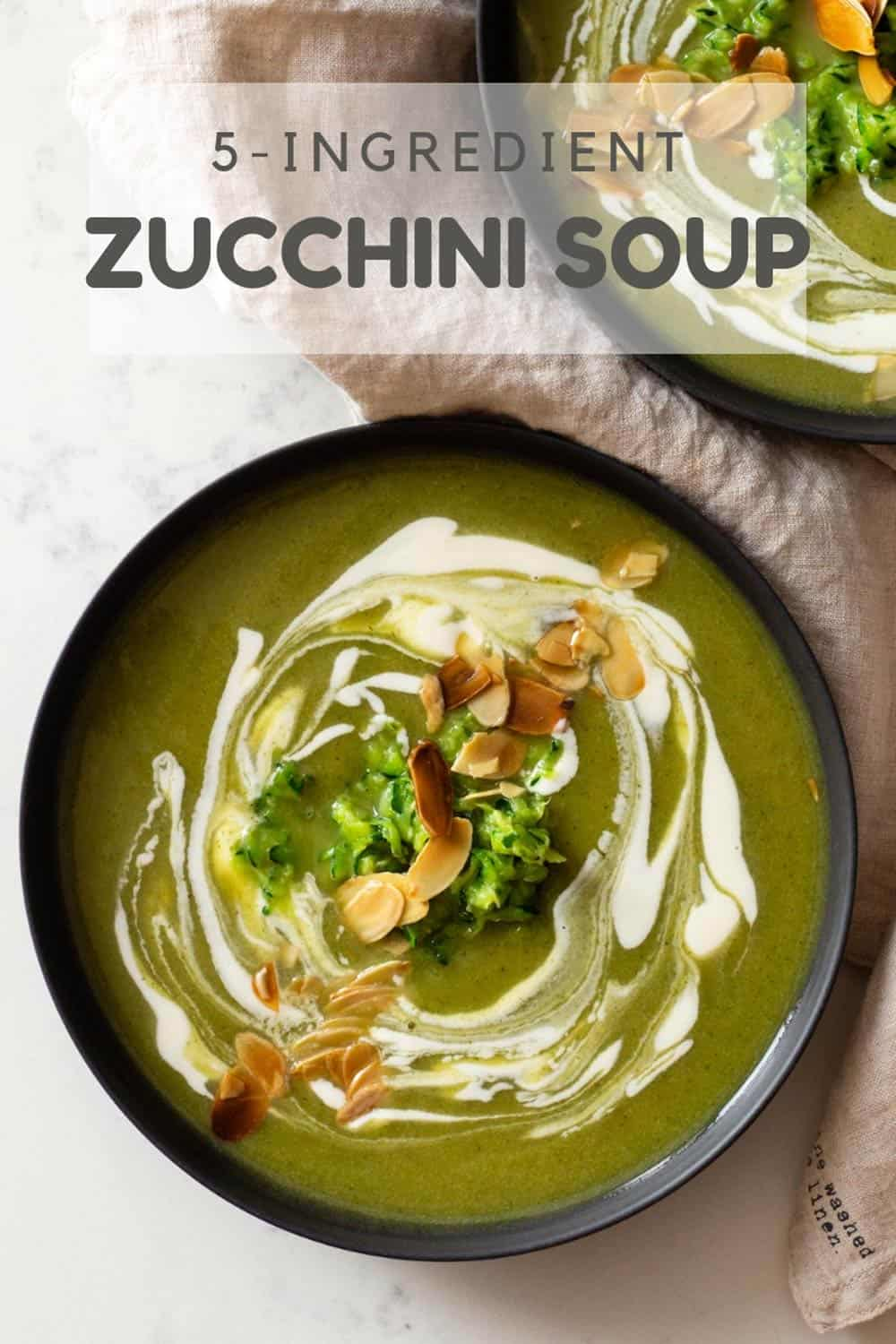 Zucchini Soup in Bowl topped with crème fraîche and sliced almonds