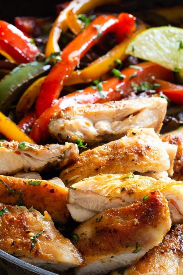 chicken fajitas cooking in cast iron skillet