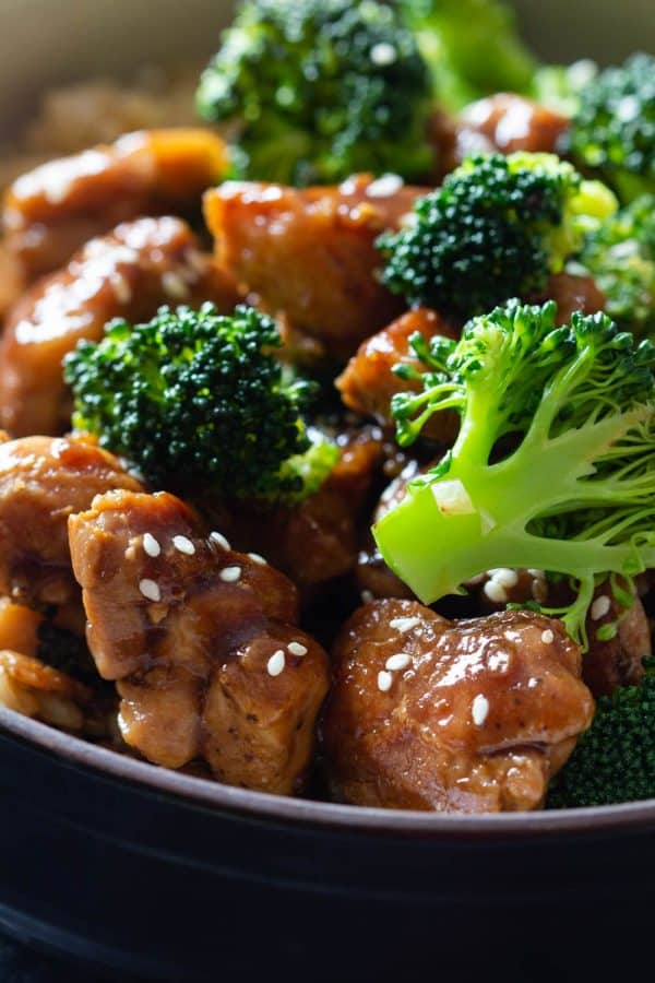 Closeup shot of chicken and broccoli in a soy-sauce stir-fry sauce