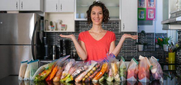 18 freezer meals on kitchen counter, Lorena in background