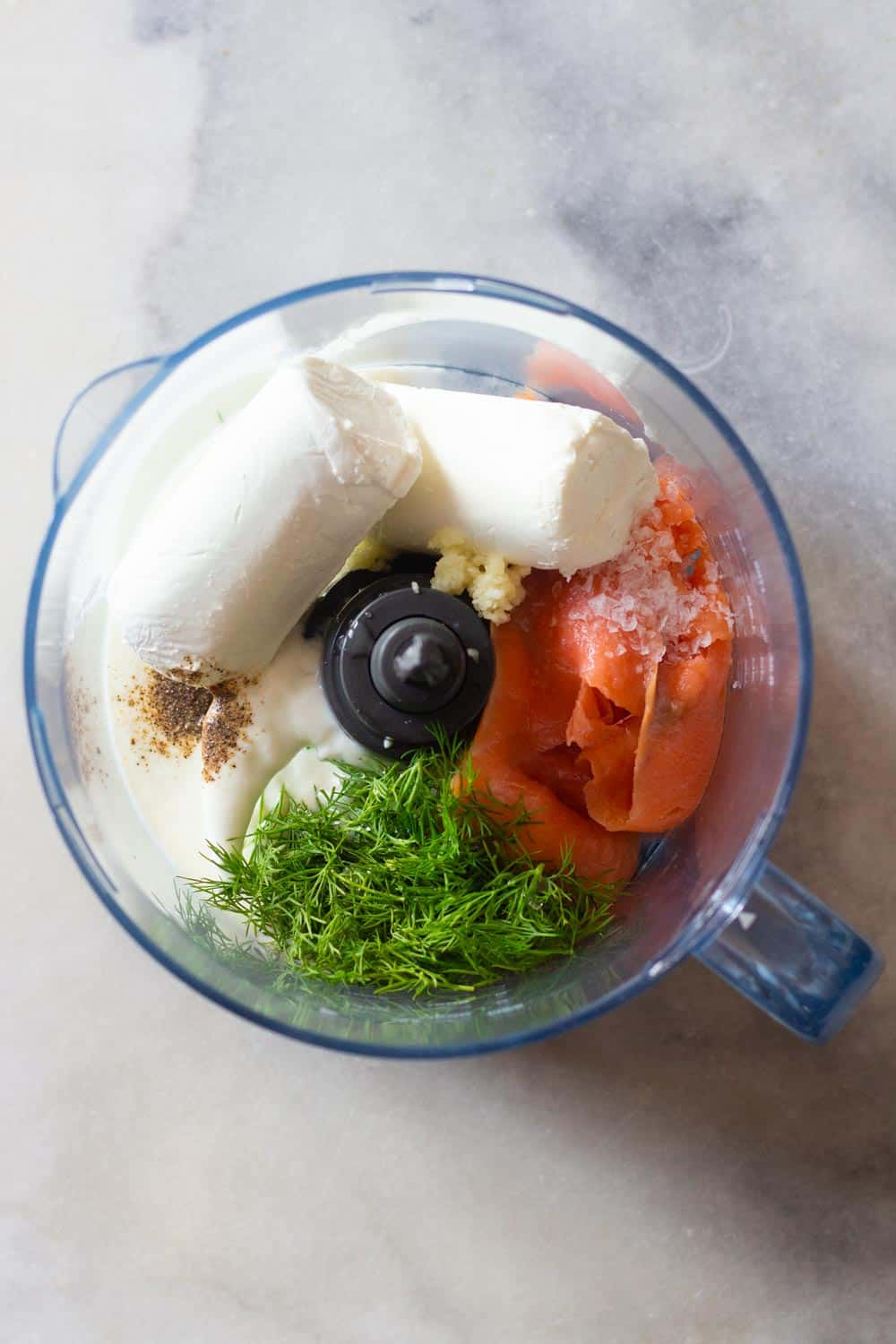 Ingredients for smoked salmon dip in a food processor