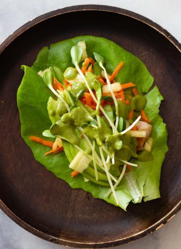 Chicken Lettuce Wrap on a wooden plate