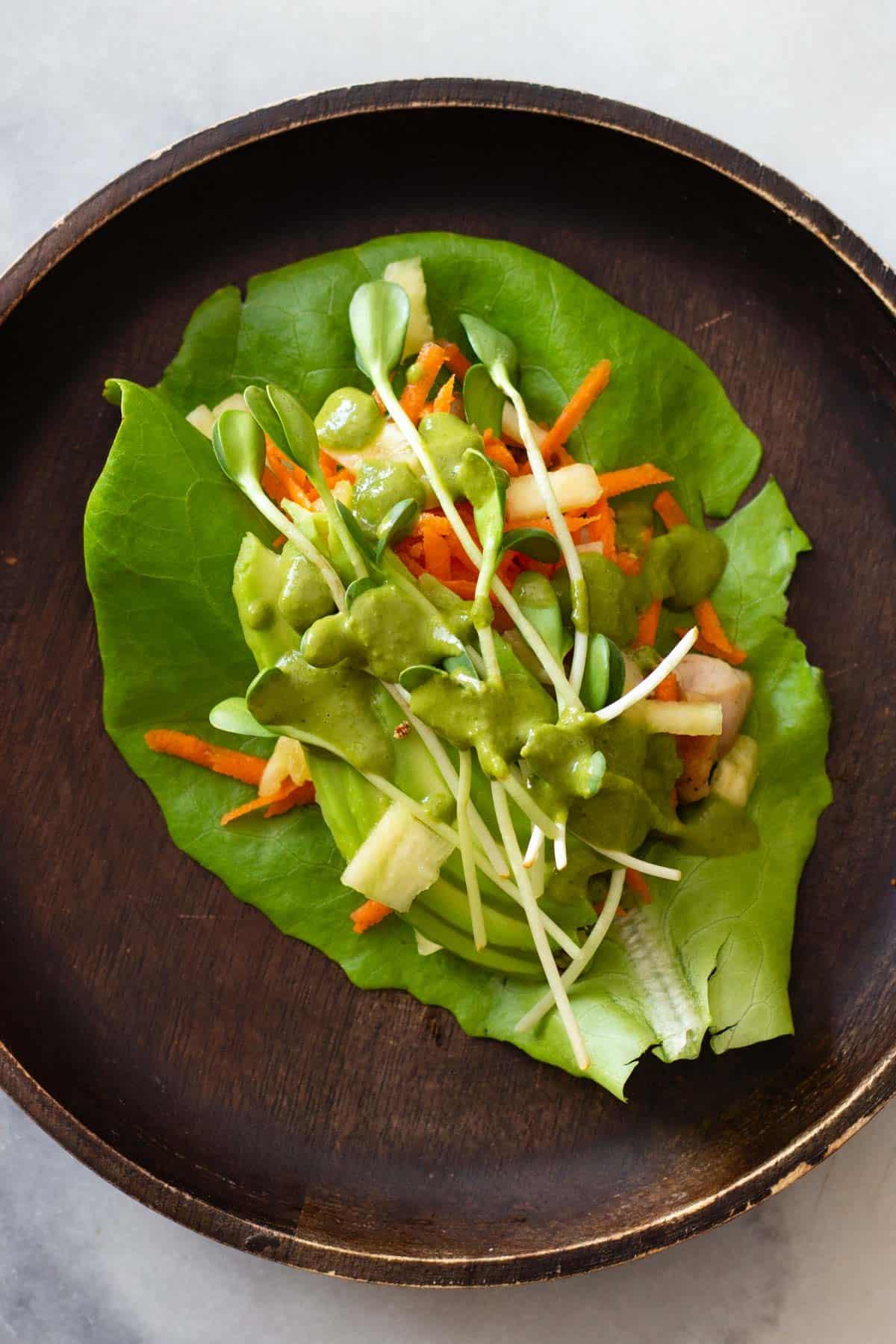 Chicken Lettuce Wrap on a wooden plate