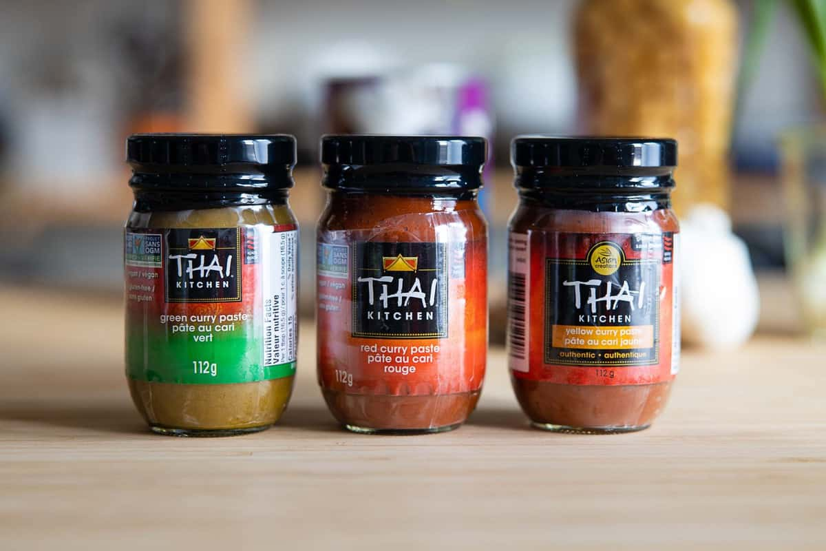 3 jars of Thai curry paste: green, red, and yellow.