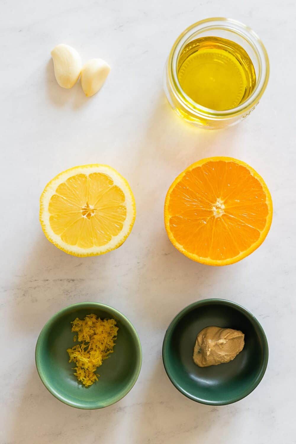 Ingredients for citrus dressing laid out on a kitchen counter.