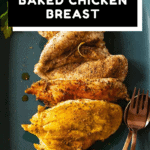 Seasoned baked chicken breast on a teal colored platter with text overlay for Pinterest.