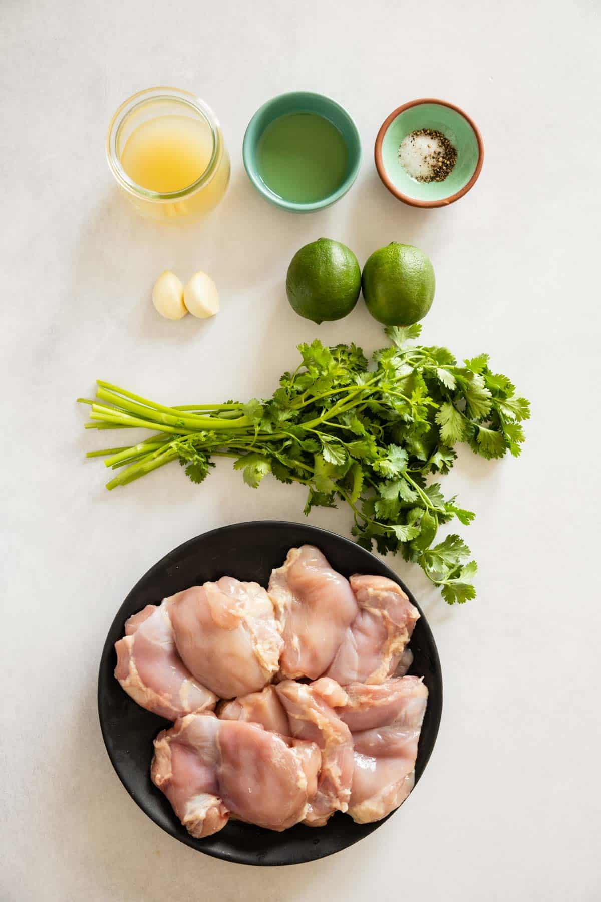 Ingredients for cilantro lime chicken thighs laid out on a kitchen counter.