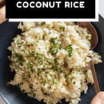 Coconut Rice in a blue bowl held in hands with text overlay for Pinterest.