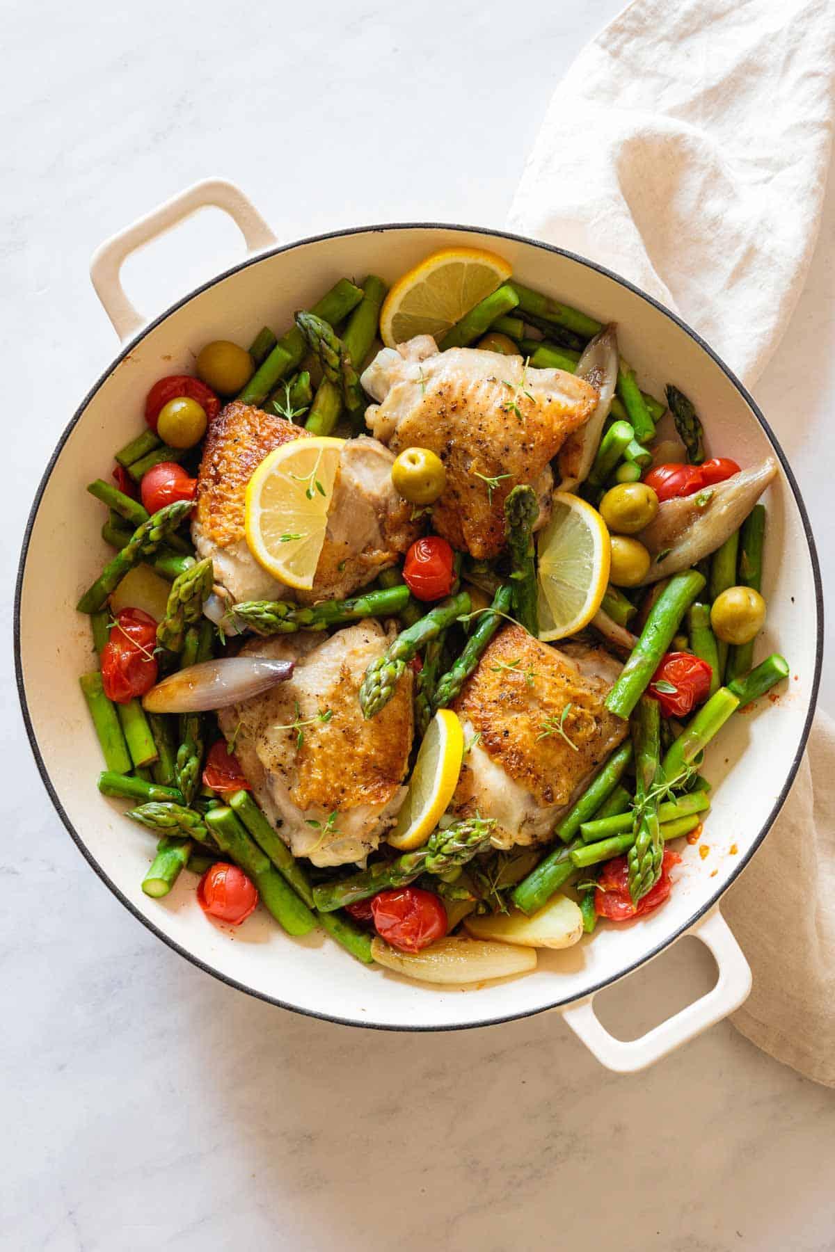 Finished Mediterranean Chicken Dinner in a white pan.