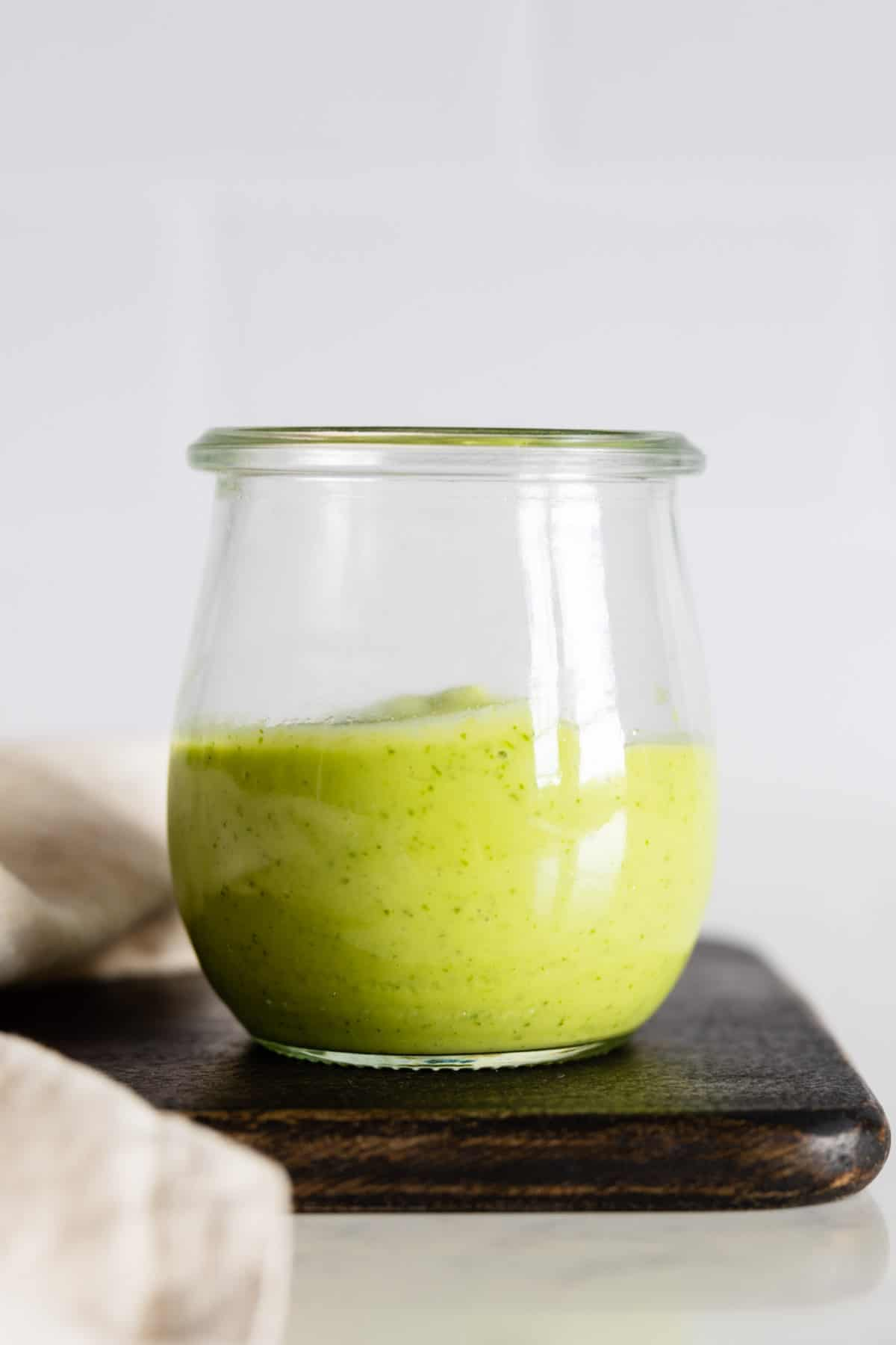 Cilantro Lime Avocado Dressing in a glass jar.