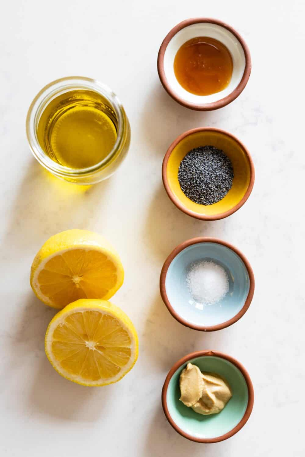 Ingredients for Lemon Poppy Seed Dressing laid out on a kitchen counter.