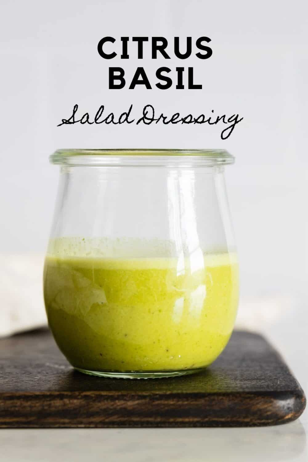 Glass jar with green salad dressing with title reading: Citrus Basil Salad Dressing.