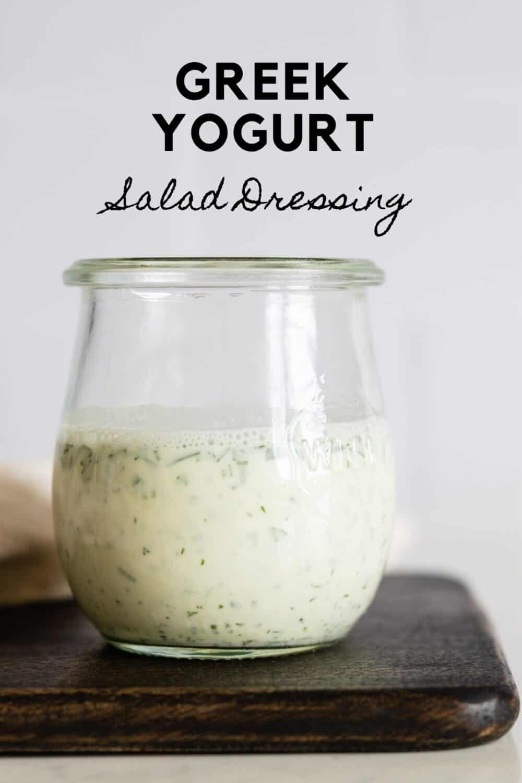 Glass jar with white salad dressing with title reading: Greek Yogurt Salad Dressing.