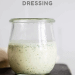 Greek Yogurt Herb Dressing in a glass jar with text overlay for Pinterest.