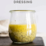 Lemon Poppy Seed Salad Dressing in a small glass jar with text overlay for Pinterest.